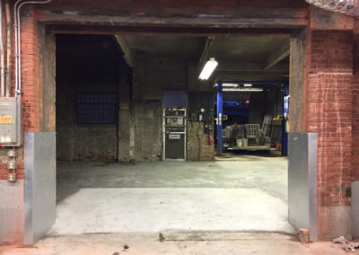 Passageway, New Floor & Overhead Door